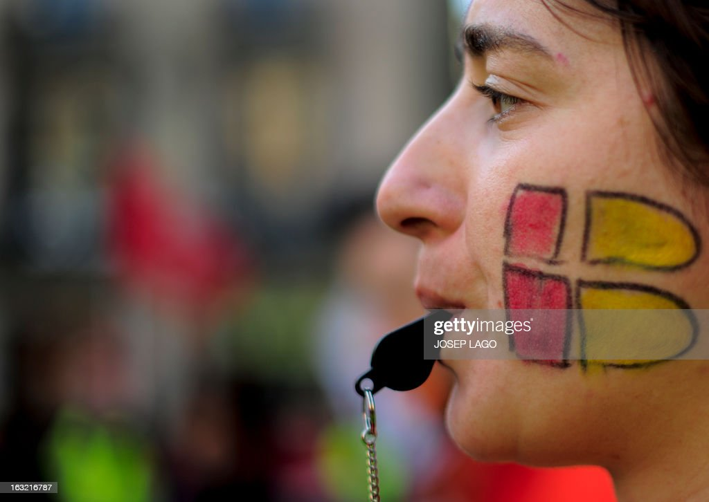 A striker of Spanish airline Iberia blows a whistle during a demonstration at Sant Jaume square in Barcelona on March 6, 2013. Workers at Spanish airline Iberia launched a second round of strikes against mass job cuts forcing the cancellation of some 250 flights.
