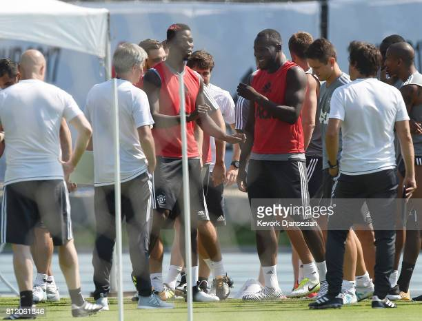 Striker Romelu Lukaku and Paul Pogba of Manchester United laugh as manager Jose Mourinho looks on during training for Tour 2017 at UCLA's Drake...