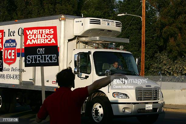 A striker tries unsuccessfully to convince a truck driver to honor the Hollywood writers' picket line near the gate at the CBS Radford Studios after...
