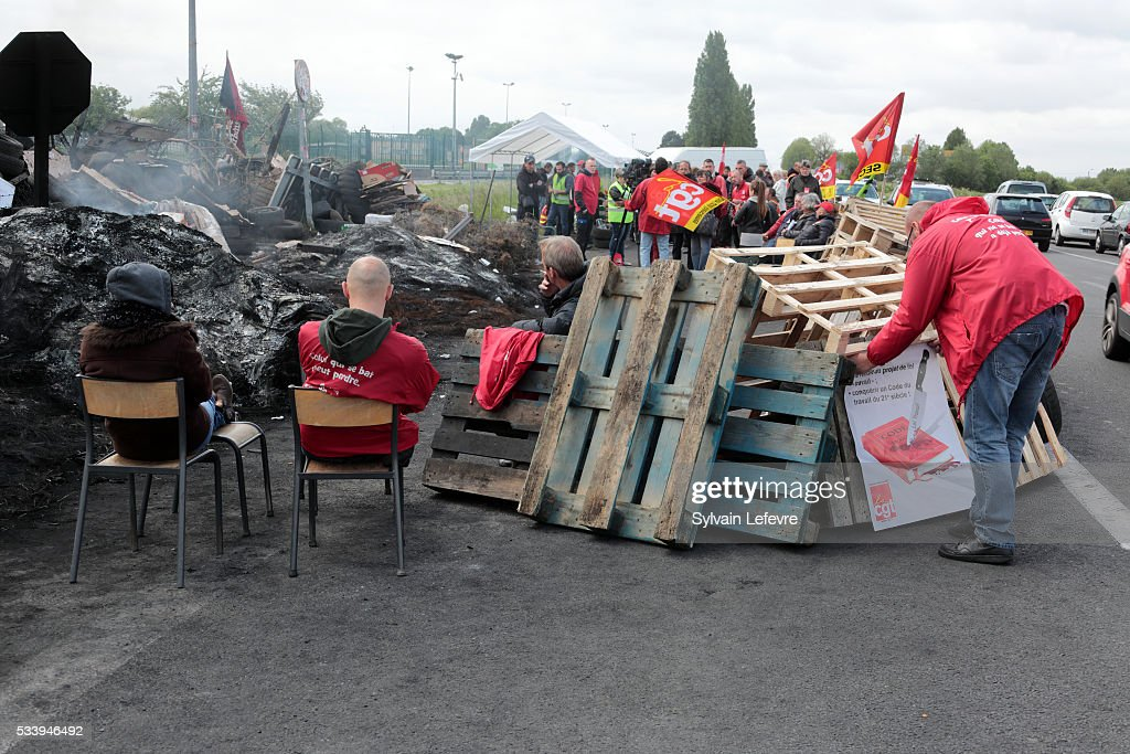 Strikers block access to the fuel depot of Haulchain, near Valenciennes, Northern France to protest against labour and employment law reforms on May 24, 2016 in Valenciennes, France.