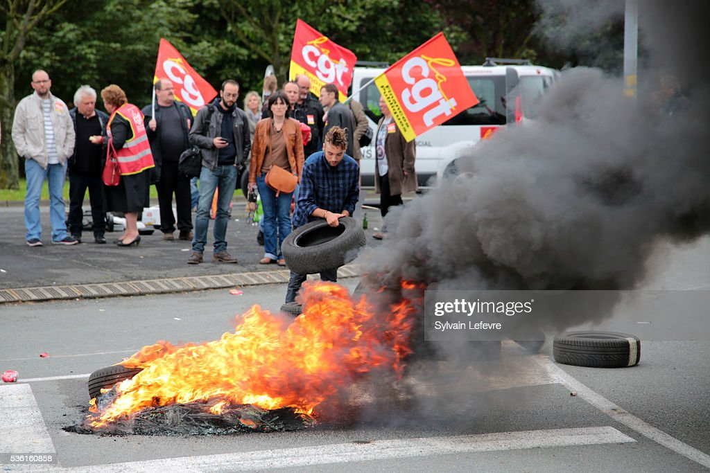 Strikers block the road near Simmons Bedding Company as Emmanuel Macron, French Minister of Economy, comes to visit the company on May 31, 2016 in Saint-Amand-Les-Eaux near Valenciennes, France.