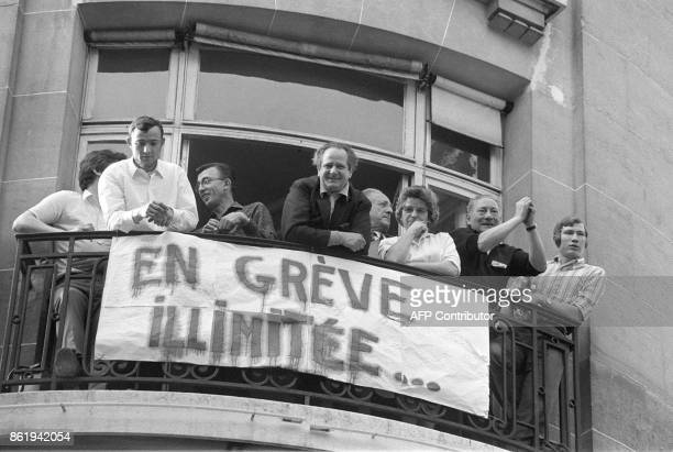 Strikers watch from their balcony the big demonstration called by the CGT union in Paris 29 May 1968 during the May 1968 movement and general strike...
