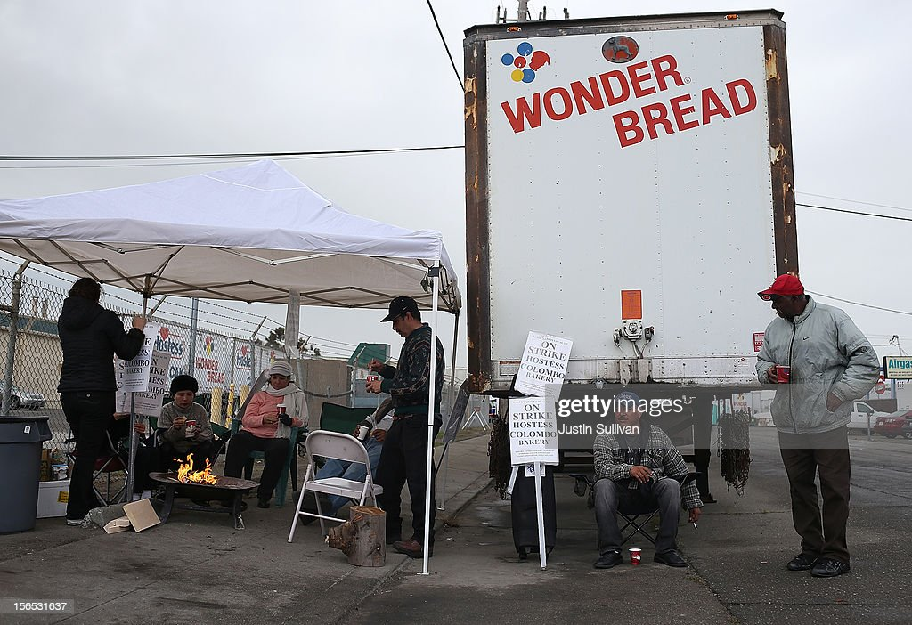 Striking bakery workers stand near a truck outside of the Hostess baking facility on November 16, 2012 in Oakland, California. Hostess Brands, the maker of Twinkies, Ding Dongs and Wonder Bread, announced plans to liquidate its assets and lay off nearly 18,500 employees due to a workers strike brought on by an imposed contract that would cut workers' wages by 8 percent.