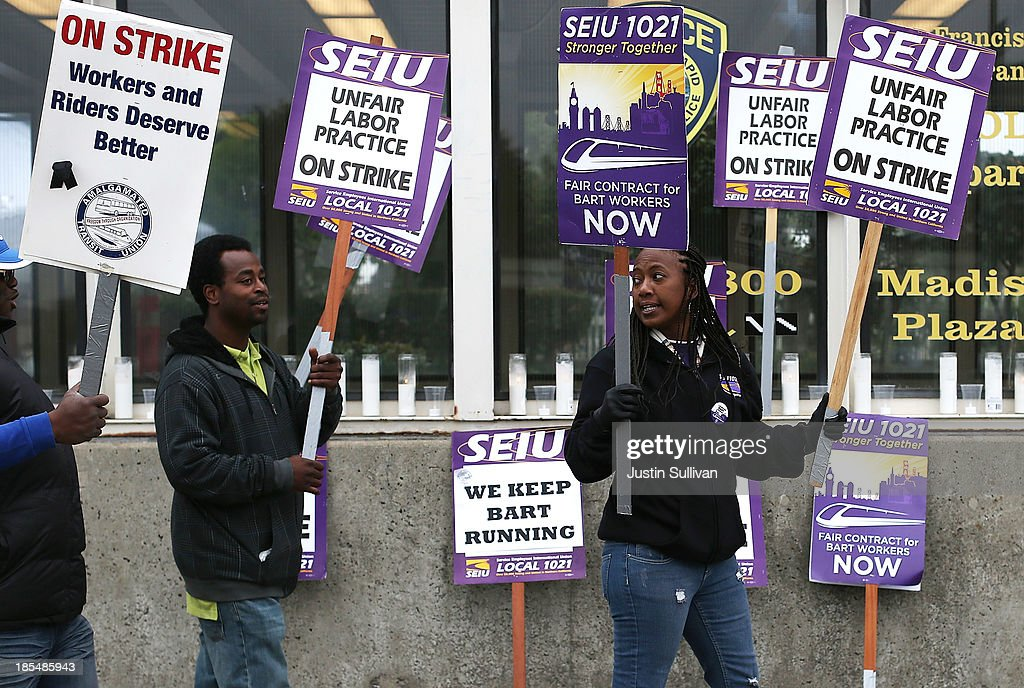 Striking Bay Area Rapid Transit (BART) workers picket in front of the Lake Merritt station on October 21, 2013 in Oakland, California. BART workers continue to strike after contract negotiations between BART management and the transit agency's two largest unions fell apart last week. Management and unions agreed on the financial specifics of the contract but differed on workplace safety rules. An estimated 400,000 commuters ride BART each day.