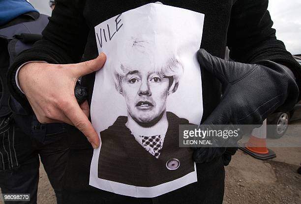 Striking British Airways cabin crew demonstrate with a picture of BA chief executive Willie Walsh's face superimposed onto a photograph of British...