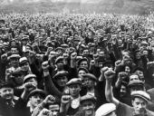 Striking building workers raise their fists in salute during a rally in the Bois de Vincennes Paris 13th June 1936