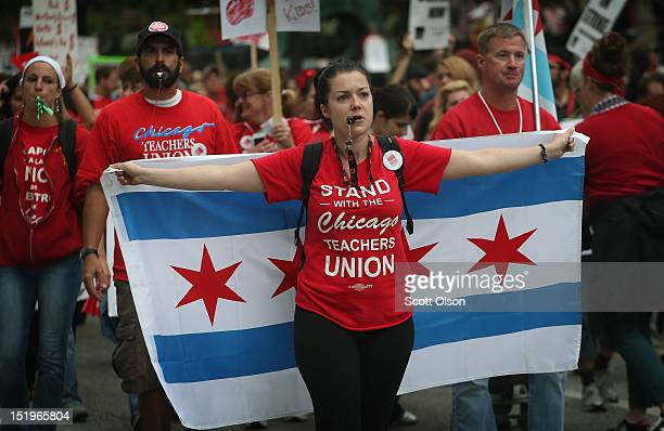 Striking Chicago public school teachers and their supporters march down Michigan Avenue on September 13 2012 in Chicago Illinois More than 26000...