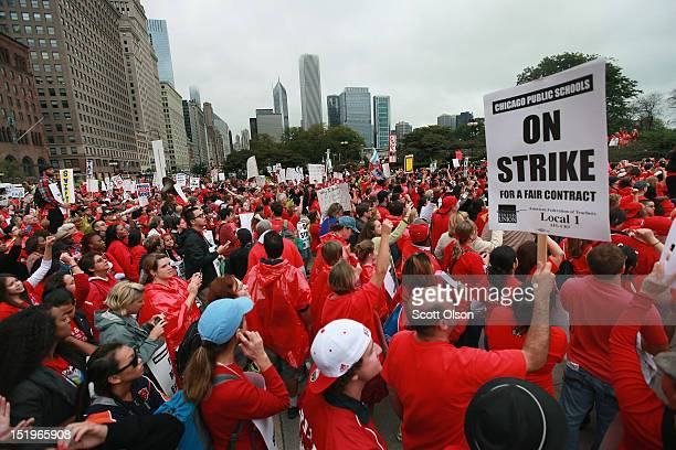 Striking Chicago public school teachers and their supporters rally following a march down Michigan Avenue on September 13 2012 in Chicago Illinois...
