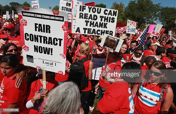 Striking Chicago teachers and their supporters attend a rally at Union Park September 15 2012 in Chicago Illinois An estimated 25000 people gathered...