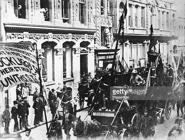 Striking dock workers march down Leadenhall Street during the London Dock Strike of 1889