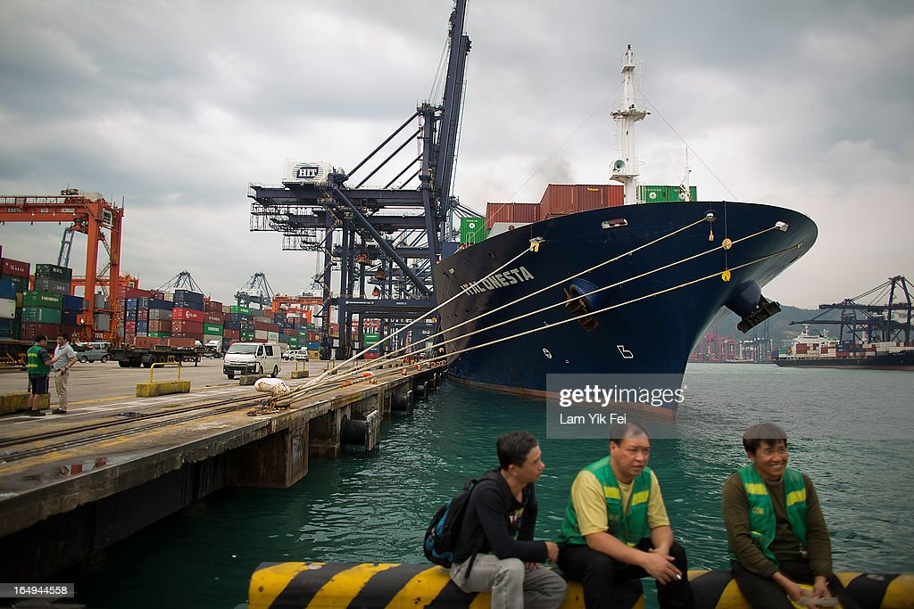 Striking dockers sit on the quayside at the Kwai Chung Container Terminal on March 29, 2013 in Hong Kong, China. Over 100 workers, who are employed by Hongkong International Terminals, have taken strike action as they demand higher wages, claiming that that they have not received a pay raise in 15 years.