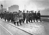 Striking engineers crossing Blackfriars Bridge London on a march to Memorial Hall