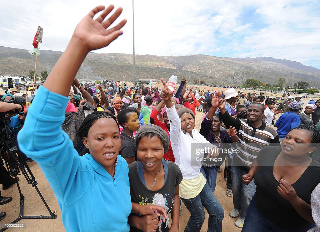 Striking farmworkers on November 12, 2012 in De Doorns, Western Cape Province, South Africa. The rural town of De Doorns was a site of violent protests as thousands of farmworkers demanded their wages be doubled to R150 per day.