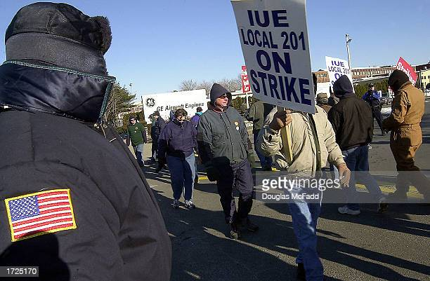 Striking General Electric workers from the Local 201 Union picket outside the GE Aircraft Engines plant January 14 2003 in Lynn Massachusetts...