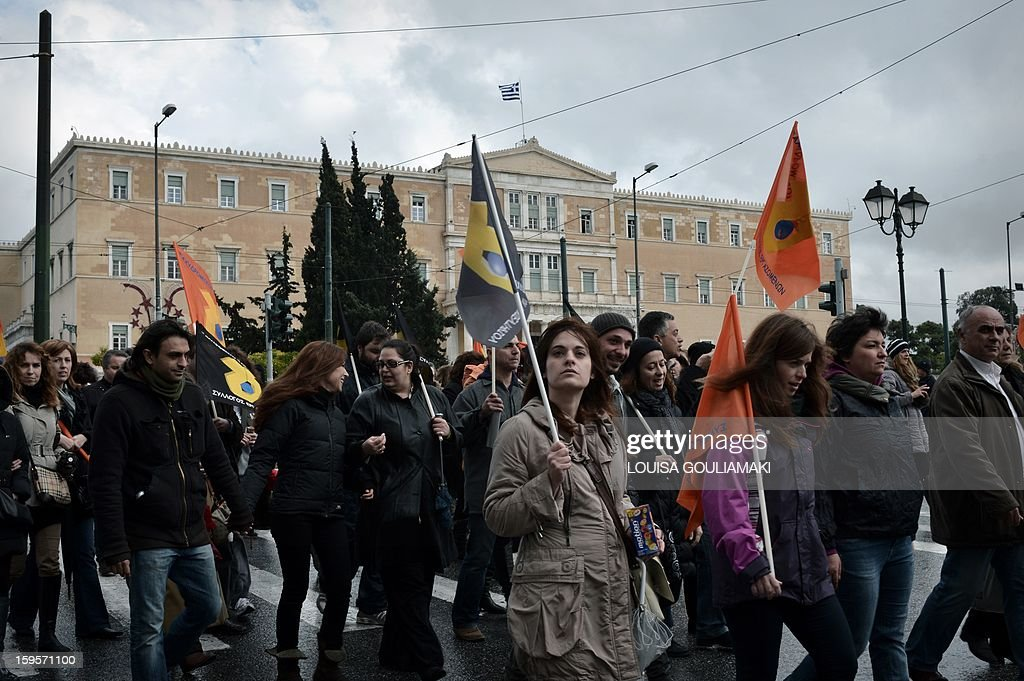 Striking Hellenic Postbank employees march towards the finance ministry in Athens on January 16, 2013 protesting against bank's planned split and privatization. Greece had originally pledged to raise 50 billion euros through the sale or lease of state assets by 2015, a commitment made to the European Union and the International Monetary Fund in return for debt bailout funds. This was later scaled down to 19 billion, and in October the government said it planned to raise just 9.5 billion euros by 2016. AFP PHOTO/ Louisa Gouliamaki