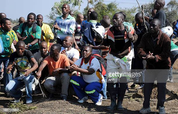 Striking Lonmin mine workers dance and sing as they gather on a hill called Wonderkop on May 14 2013 in Marikana where 34 people were shot and killed...
