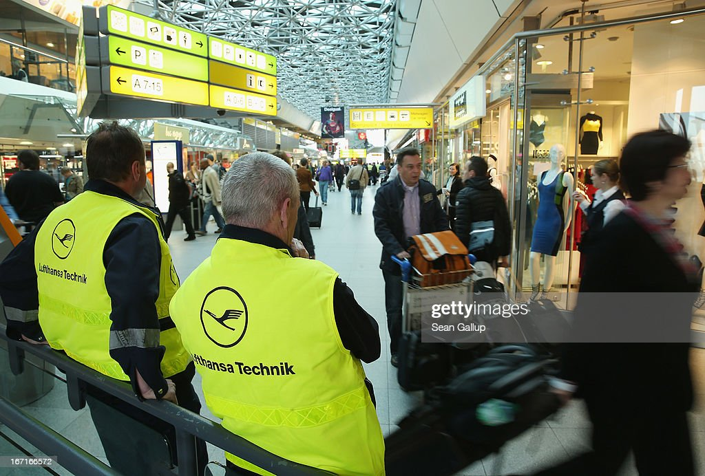 Striking Lufthansa technical maintenance employees stand in the main terminal at Tegel Airport during a nationwide strike by Lufthansa ground, service and maintenance personnel on April 22, 2013 in Berlin, Germany. Workers are demanding pay raises and job guarantees and today's strike has forced Lufthansa to cancel approximately 1700 flights.
