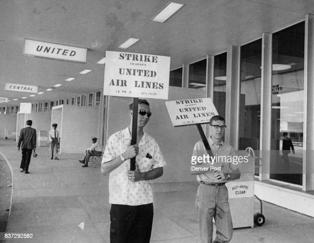 Striking Machinists Picket at the entrance to United Air Lines Ticket Area at Stapleton Jim Klotz left and Dennis Downs were among 804 Denver union...