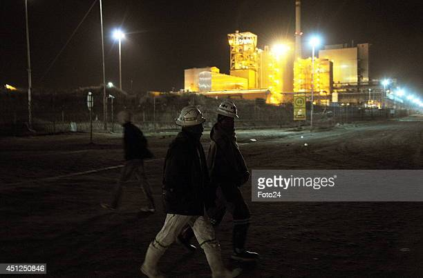 Striking miners return to work on June 25 2014 in Marikana South Africa Amcu signed the new wage deal on Tuesdsay ending the fivemonth platinum...
