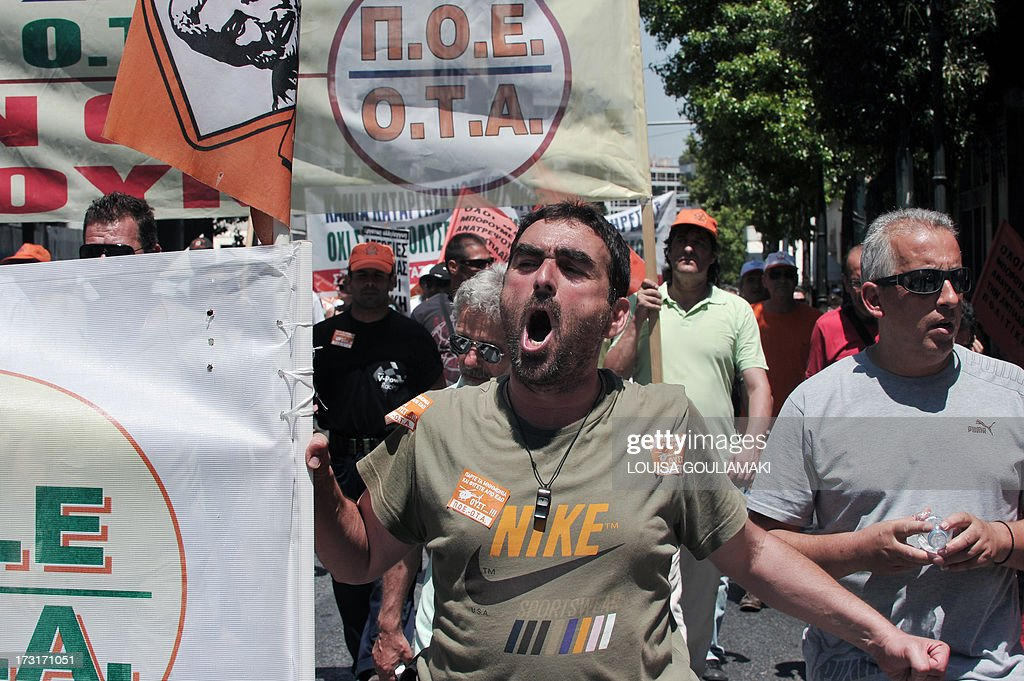 Striking municipal worker march on July 9, 2013 during a protest in Athens. Greek municipal workers went on strike for the second consecutive day on July 9, protesting against job cuts enacted by the government in return for promised EU-IMF rescue loans. AFP PHOTO/ LOUISA GOULIAMAKI