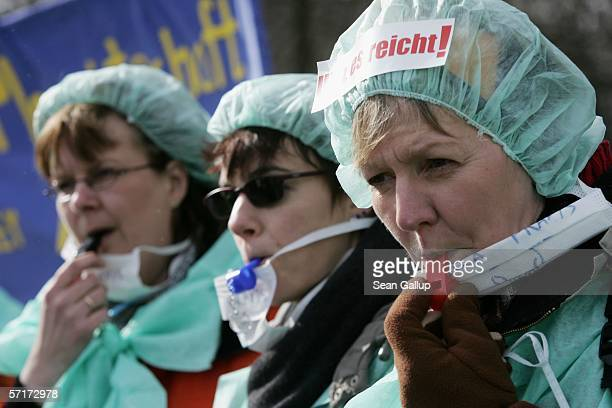 Striking nurses blow whistles during a protest march March 24 2006 in Berlin Germany An estimated 30000 thousand attended the march as clinic and...