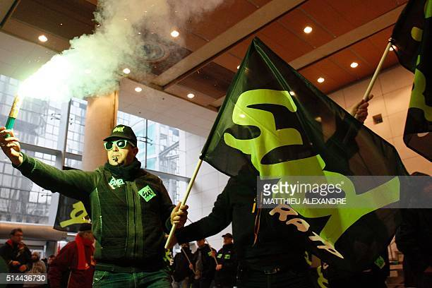 Striking rail workers demonstrate to call for better work conditions in front of the headquarters of the RATP on March 9 2016 in Paris as part of a...