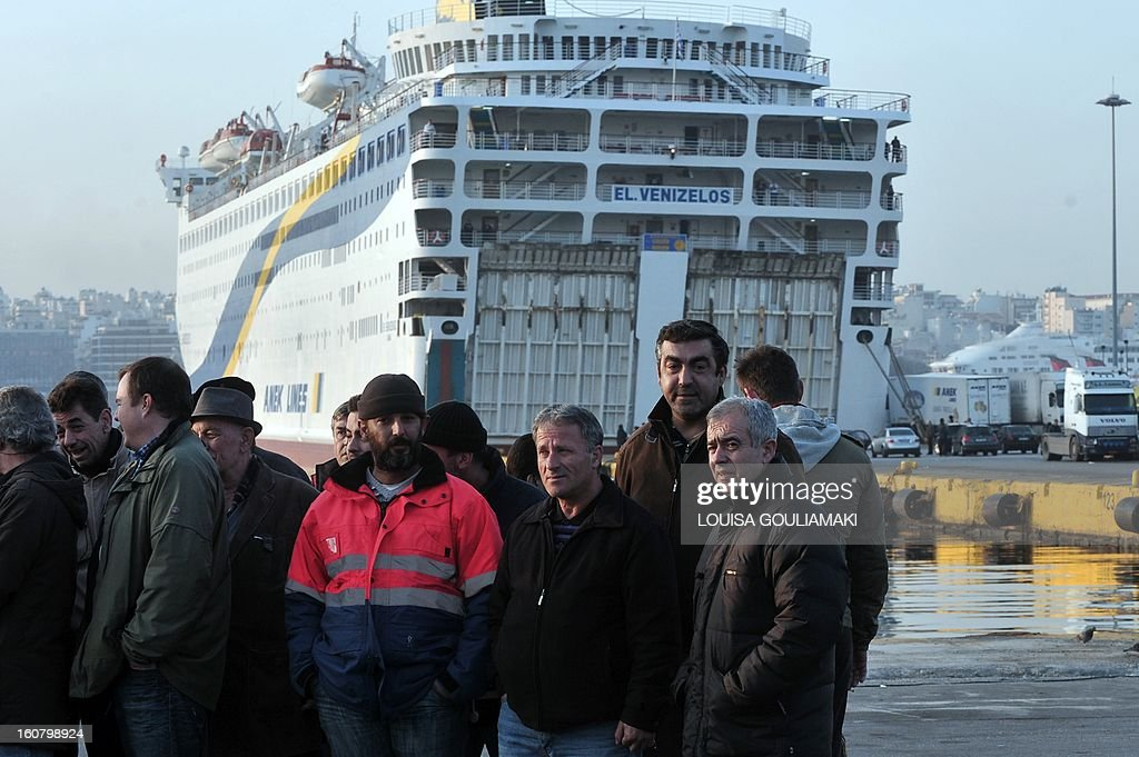 Striking seamen stand on the Greece's main harbour Piraeus port early on February 6, 2013 in Athens during the forced end to a strike movement by seamen. Riot police were sent to Greece's main harbour Piraeus early on Wednesday to end a strike by seamen that has disrupted ferry services to the country's myriad islands for nearly a week, enforcing an emergency government order that took effect at 0400 GMT to force the strikers back to work.