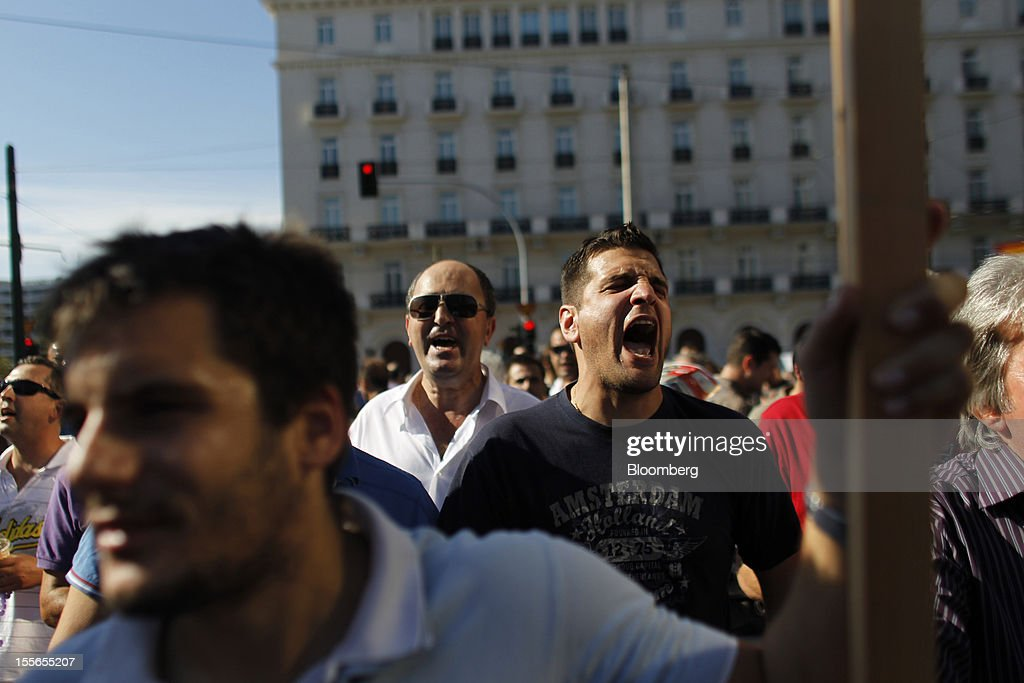 Striking taxi drivers shout slogans during a general strike protest in Athens, Greece, on Tuesday, Nov. 6, 2012. Greece headed for a cliffhanger vote on austerity measures needed to keep the bailout on track as a 48-hour general strike began and European officials squabbled over the timing of a deal to unlock rescue funds. Photographer: Kostas Tsironis/Bloomberg via Getty Images