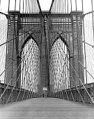 A striking view of the Promenade over the famous Brooklyn Bridge New York New York 1920s The bridge was completed in 1883 at a total cost of 25...
