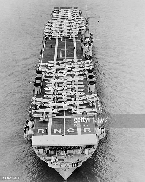 A striking view of the USS Ranger aircraft carrier of the United States Navy with a part of her brood of planes on her flight deck The photo appears...