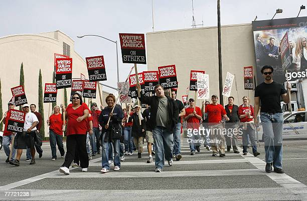 Striking writers picket outside Warner Brothers Studios after contract talks between the Writers Guild of America and the Alliance of Motion Picture...