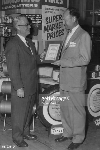 W A Strimple Denver division manager of The Texas Co presents a service award to Harry Leisenring Texaco dealer at 801 W 6th Ave who has served the...