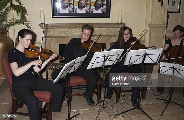 A string quartet at a party thrown by Lennox Lewis to celebrate the defense of his World Heavyweight Boxing Champion title and his recent CBE held at...