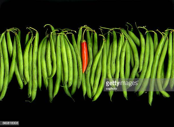 Stringbeans and chili isolated on black background