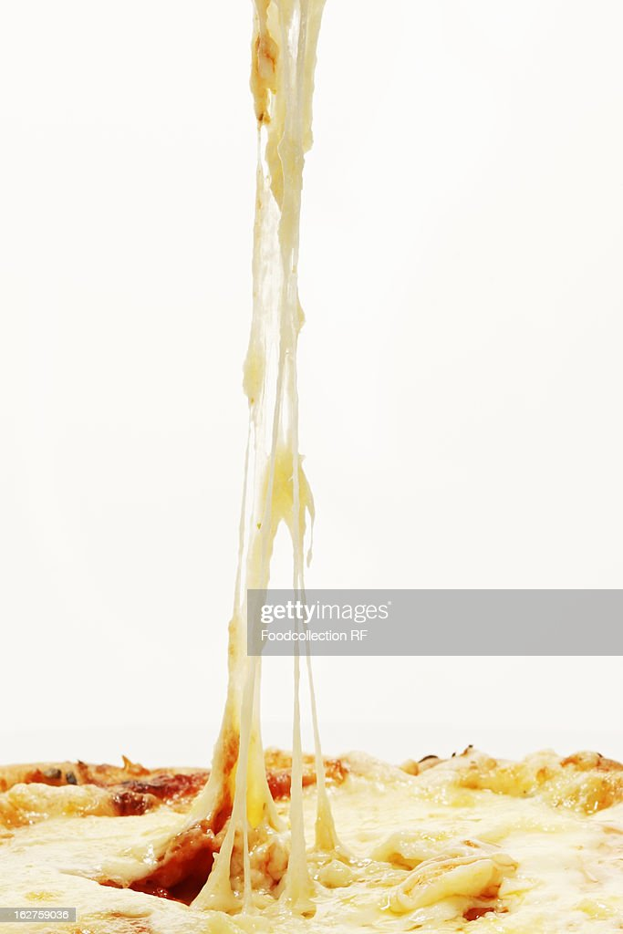 Strings of cheese coming off pizza