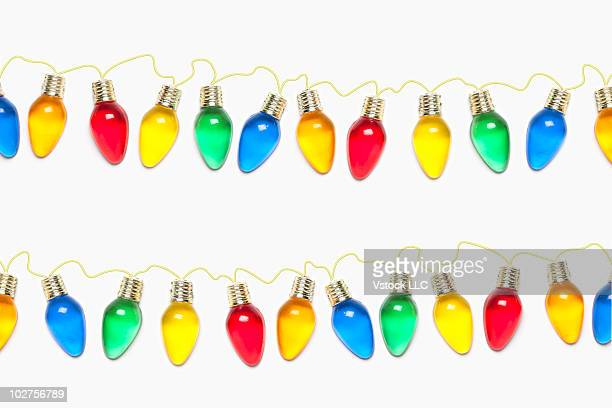 Strings of colored Christmas light bulbs
