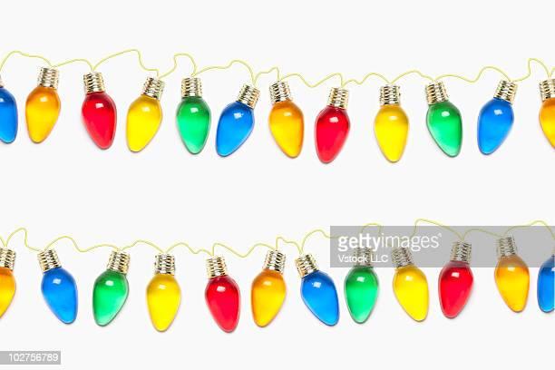 Strings of colored Christmas light bulbs