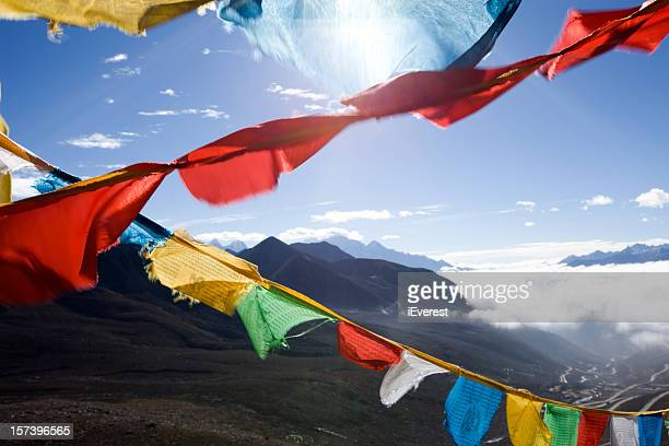 Strings of Tibetan prayer flags in different colors