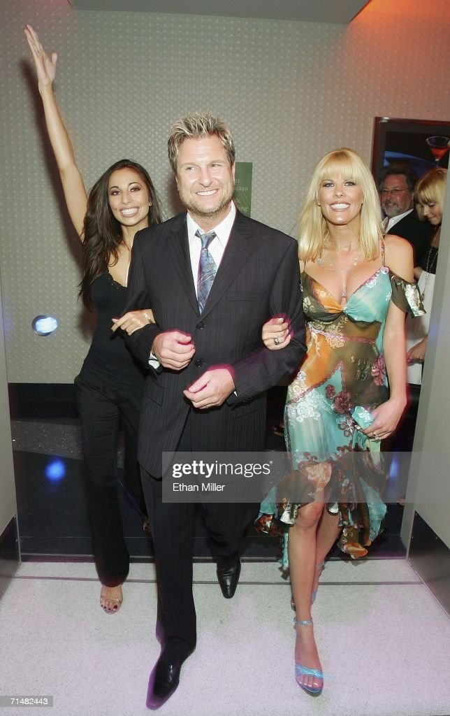 Strip Las Vegas magazine publisher and Editor-in-Chief Scott Santos (C) escorts adult film actresses Tiffany Taylor (L) and Sunset Thomas (R) to a party for the release of Thomas' cover issue of the publication at the Palms Casino Resort July 18, 2006 in Las Vegas, Nevada. Thomas, who stars in the HBO series 'Cathouse,' will open Diamond Jack & Sunset Thomas' Gentlemen's Club in Reno, Nevada next month, and is launching a clothing line called Sunset Wear.