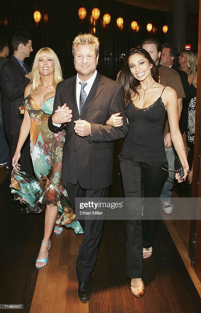 Strip Las Vegas magazine publisher and Editor-in-Chief Scott Santos (C) escorts adult film actresses Sunset Thomas (L) and Tiffany Taylor (R) to a party for the release of Thomas' cover issue of the publication at the Palms Casino Resort July 18, 2006 in Las Vegas, Nevada. Thomas, who stars in the HBO series 'Cathouse,' will open Diamond Jack & Sunset Thomas' Gentlemen's Club in Reno, Nevada next month, and is launching a clothing line called Sunset Wear.