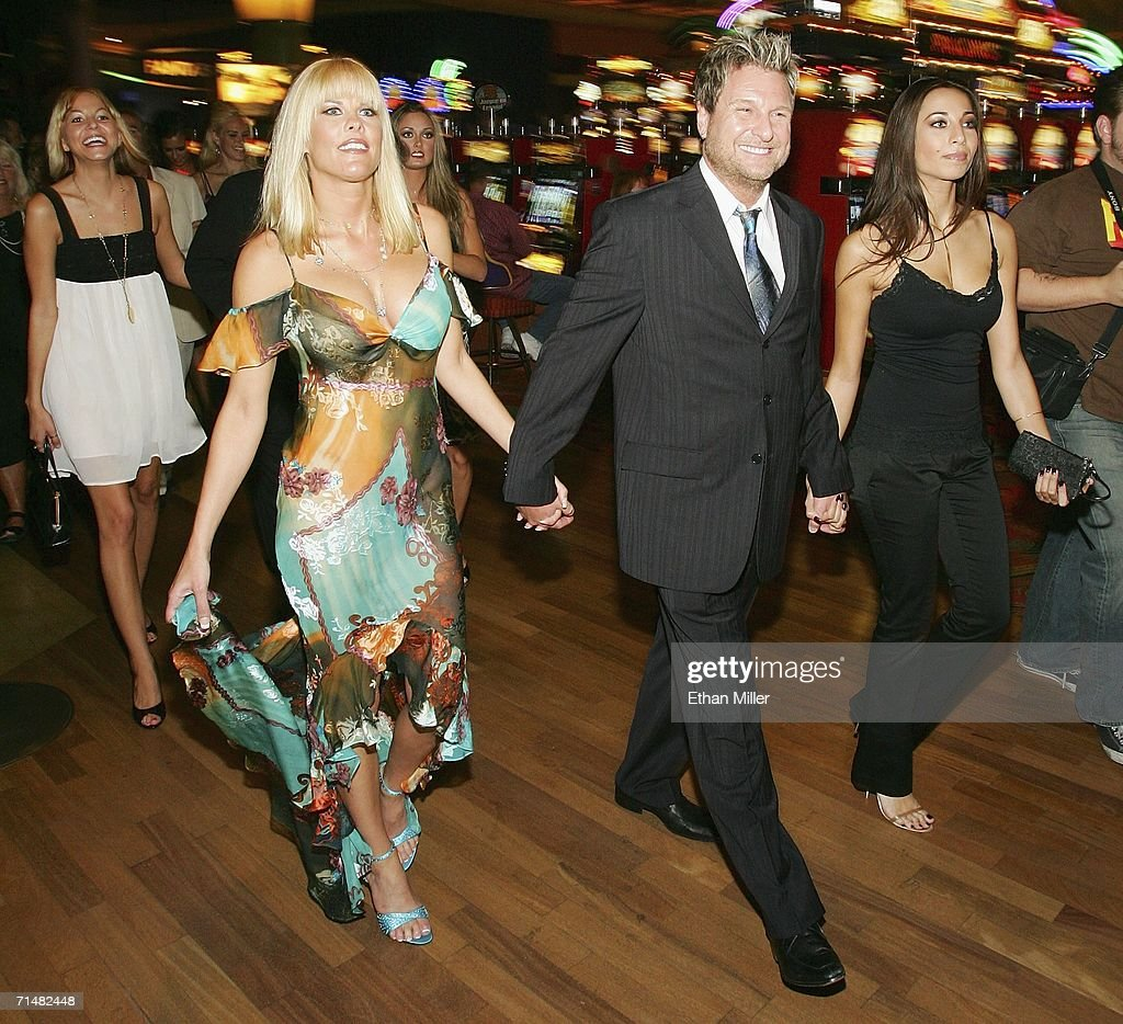 Strip Las Vegas magazine publisher and Editor-in-Chief Scott Santos (3rd L) escorts model Kristin McCormick (L) and adult film actresses Sunset Thomas (2nd L) and Tiffany Taylor (R) to a party for the release of Thomas' cover issue of the publication at the Palms Casino Resort July 18, 2006 in Las Vegas, Nevada. Thomas, who stars in the HBO series 'Cathouse,' will open Diamond Jack & Sunset Thomas' Gentlemen's Club in Reno, Nevada next month, and is launching a clothing line called Sunset Wear.