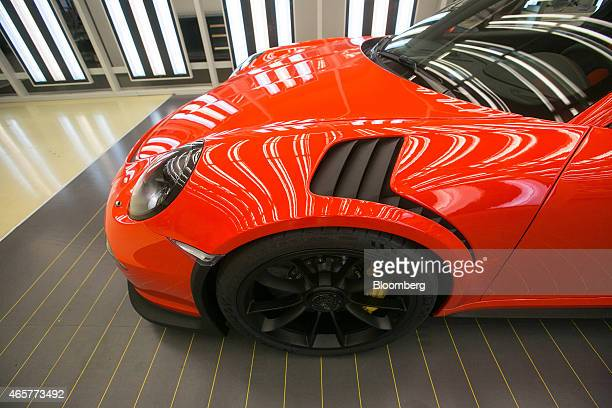Strip lights reflect off the polished bodywork of a red Porsche 911 GT3 RS automobile ahead of shipping from the Porsche AG factory in Stuttgart...