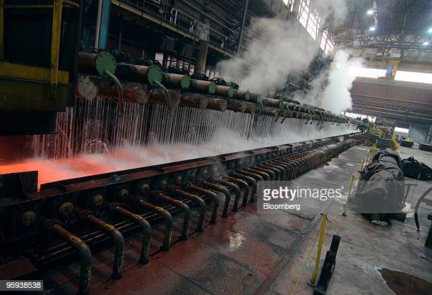 A strip of steel passes through a laminar cooling process at the ArcelorMittal Ostrava steel plant in Ostrava Czech Republic on Thursday Jan 21 2010...