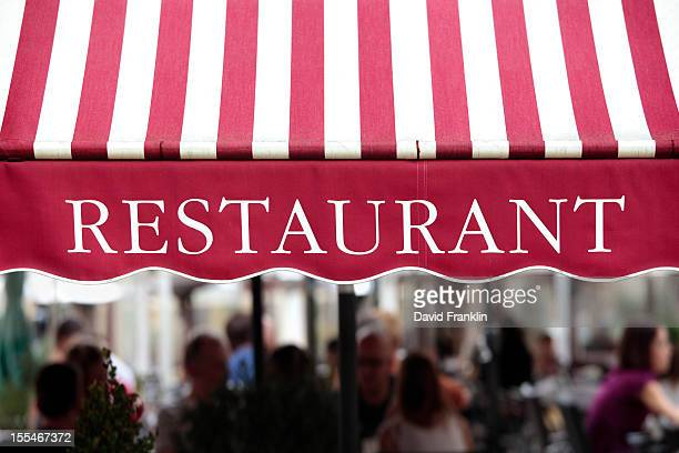 Striped awning over outside diners, Paris