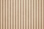 Striped beige wall paper.