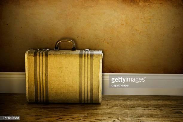 Striped briefcase on wooden floor