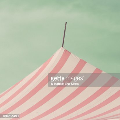 Striped circus tent at beach : Stock Photo