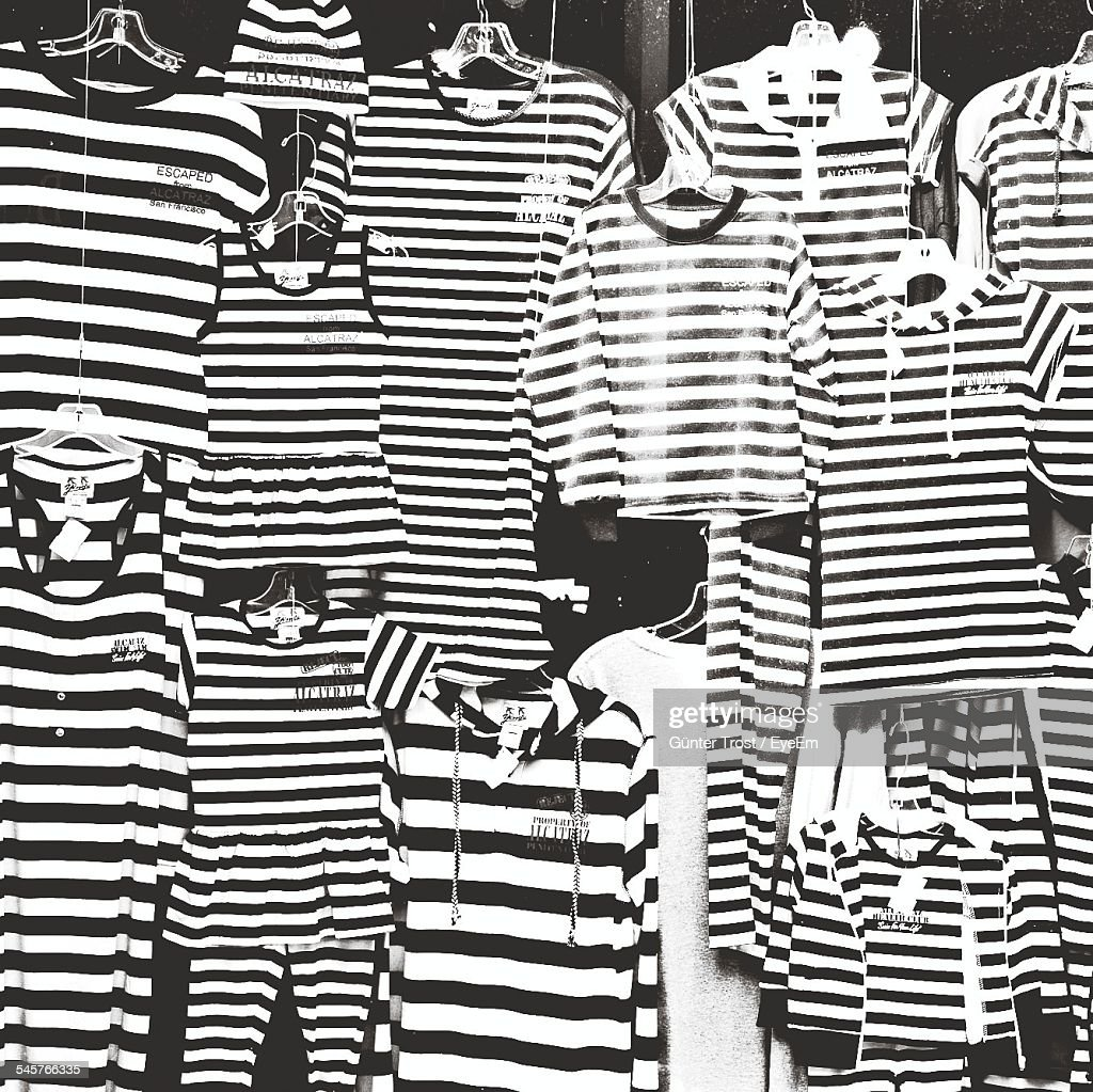 Striped Clothes Hanging On Store Window