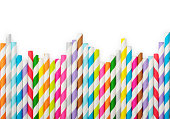 Striped drink straws of different colors in row isolated on white background