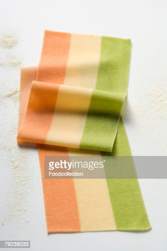 Striped pasta dough in three colours : Stock Photo